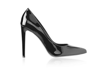 Women's black shoes from a varnish on a white background