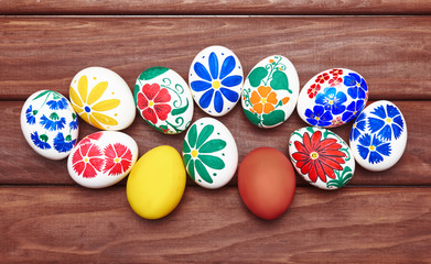 Hand painted easter eggs on the wooden table