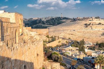 Old City wall in Jerusalem Old City and Mount of Olives in the background, Israel.