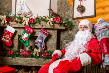 Bearded Santa Claus sitting in a chair