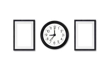 Alarm clock and two wooden photo frames mock ups on the wall, interior decor wallpaper