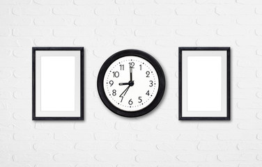 Alarm clock and two wooden photo frames mock ups on white bricks wall, interior decor wallpaper