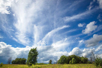Blue sky with beautiful bizarre clouds in the countryside