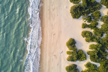 Aerial view of the Italian wild beach at sunset