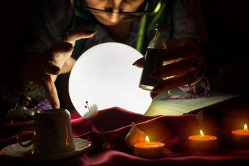 Fortune teller woman staring in crystal ball