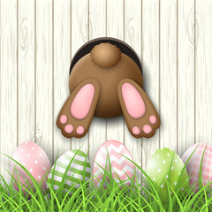 Easter motive, bunny bottom andeaster eggs in fresh grass on white wooden background, illustration