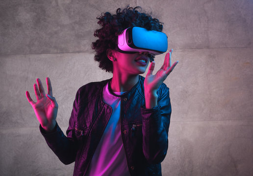A girl playing with VR headset