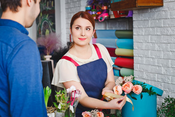 young girl working in a flower shop