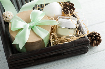 Beauty products, gift with green ribbon