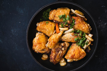 Fried chicken stew. Skillet Fried chicken with vegetable. Crispy fried chicken meat. Top view.
