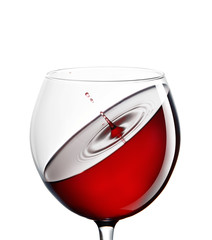 Red wine in a glass on a white background. The concept of beverages and alcohol