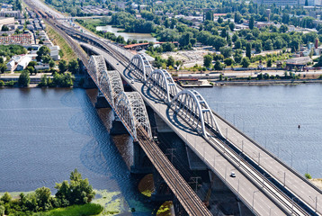 Aerial view of the Kiev (Kyiv) city, Ukraine. Dnieper river with bridges. Darnitskiy bridge