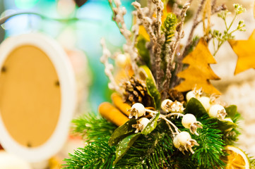 Christmas Fir Tree Toys Old wooden star hanging on branch Burning Candles, Boxes, Balls, Pine Cones, Walnuts, Branchesin the background other decorations and garlands.