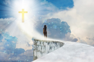 Crucifix or cross on heaven cloudy sky with lens flare and backside or rare view of women or girl on dead end high way footpath or top of wall Wall mural