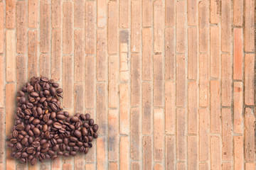 Coffee beans in form of heart on beautifull background. Love. Insparation. On wooden background.