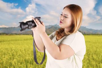 Woman looking at digital camera