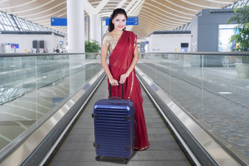 Woman with bag and saree clothes