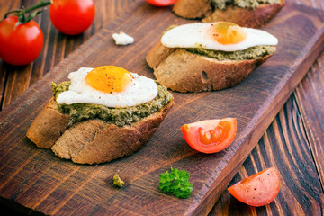 Sandwich With Fried Eggs and Pesto Sauce