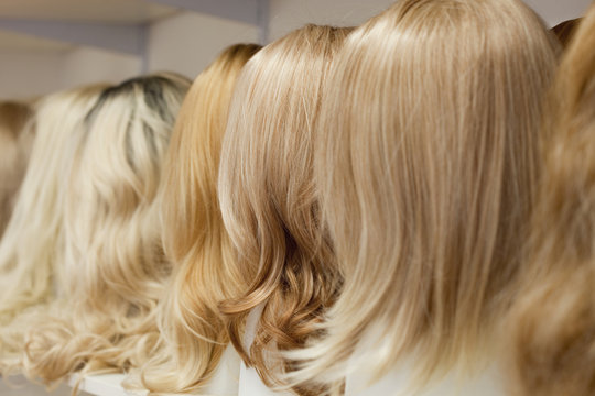 Row of Mannequin Heads with Wigs