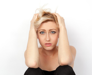 Young attractive blonde woman scared