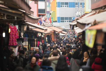 A crowd of people in the traditional Asian market.