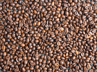 Roasted coffee beans background , captured from top view with sharp focus