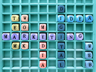 concepts of communication digital marketing formed with wood cubes in the board / Words of business marketing concepts made with letters from a set of wooden cubes