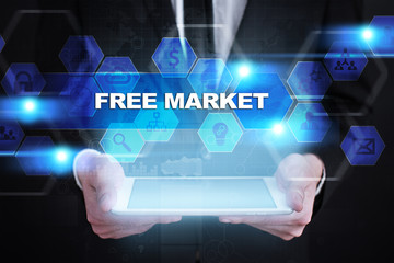 Businessman holding tablet PC with free market concept.