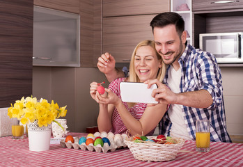 Happy Smiling Couple Making Selfie Photo While Painting Easter Eggs
