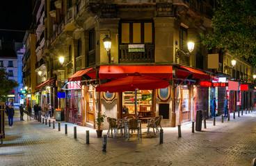 Night view of old cozy street in Madrid, Spain