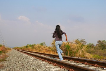 Woman running on railway, run away, need to escape, going far, towards the unknown, best way to relax, to decompress and to kill stress