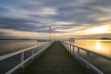 wooden pier by the sea, long exposure, evening