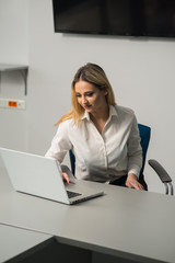 Young business woman at her office