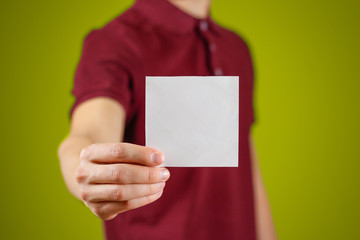 Man showing blank white square flyer brochure booklet. Leaflet presentation. Pamphlet hold hands. Man show clear offset paper. Sheet template. Booklet design sheet display read first person
