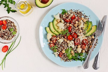 Quinoa detox salad with chick pea,avocado and cauliflower.Super food and clean eating concept.Rustic style.
