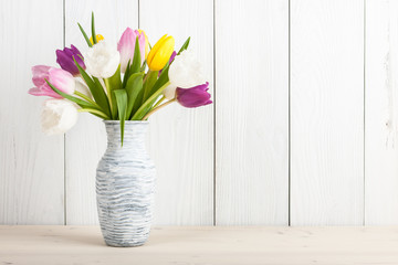 Fresh colorful tulips bouquet in jug