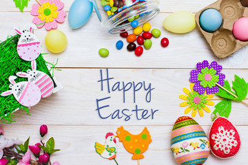Happy Easter. Colorful composition on wooden background.