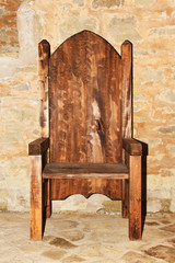 One big wooden cut beautiful arm chair