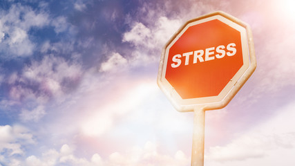 Stress, text on red traffic sign