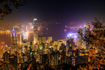 Aerial view of Victoria Harbour skyline by night from Lugard Road Lookout, the panoramic point most photographed. The Victoria Peak, the highest mountain in Hong Kong Island.