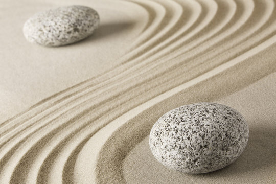 Yin and yang  Chinese Tao philosophy. Stones and sand pattern. Round rocks stand for Ying and jang in zen stone garden.