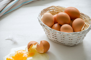 Basket with beige eggs