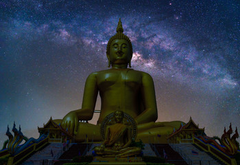Wall Mural - Landscape with Milky way galaxy. Night sky with stars and silhouette Biggest Buddha statue at temple in Thailand