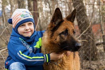 Boy and german shepherd