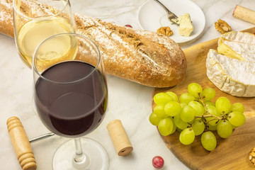 Wine and cheese tasting with bread, grapes and glass