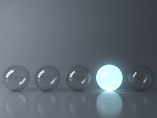 One blue glowing light ball standing out from the unlit glass balls on dark grey background with reflection and shadow , individuality and different creative idea concepts . 3D rendering.