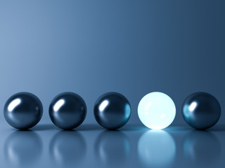 One blue glowing light ball standing out from the metal sphere balls on dark blue background with reflection and shadow , individuality and different creative idea concepts . 3D rendering.