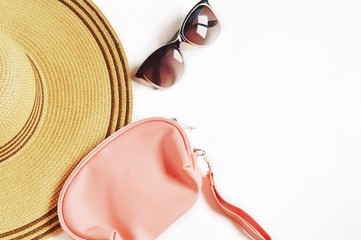 Women's Beach Accessories/ Hat, pink cosmetic bag and brown sunglasses. Flat lay photography, copy space
