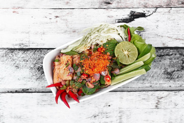 Popular Thai food ,Sliced grilled beef salad , Spicy and sour mixed vegetable salad with grilled pork , topped sliced green lemon ,red chili ,cucumber ,green oak and cabbage ,