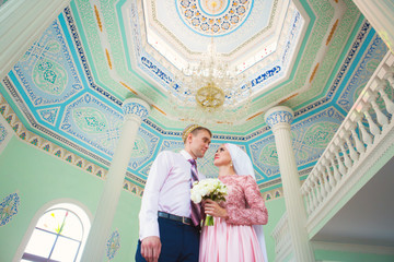 Islamic couple in a mosque on a wedding ceremony. Muslim marriage